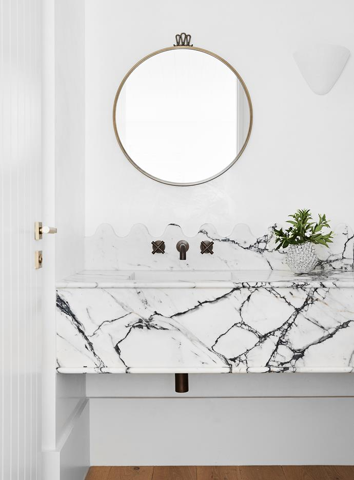 Gubi 'Randaccio' mirror by Gio Ponti, Cult Design. Brodware 'City Plus' tapware, Sydney Tap and Bathroomware. Paonazzo marble benchtop, Granite & Marble Works.