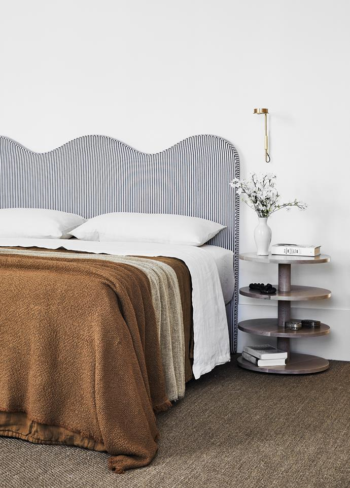 Society Limonta bedlinen, Ondene. Wiggle bedhead with upholstered bed base in Westbury Textiles 'Classic Ticking', Atelier Furniture. Custom bedside table, Chatsworth Fine Furniture. Oriental Sisal 'Boheme' carpet in Grey Ash, Artisanweave Flooring Co. W102 Chipperfield wall light, Euroluce