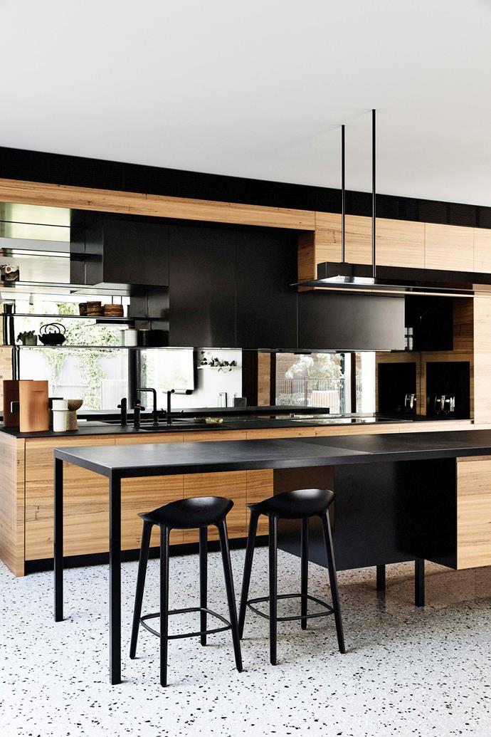 Bar stools from Great Dane introduce a touch of Scandi style to the bench. The overhead lighting, and much of the home's illumination, is by Unios. The kitchen is all-electric, meaning it relies on solar electricity rather than gas from an external source.