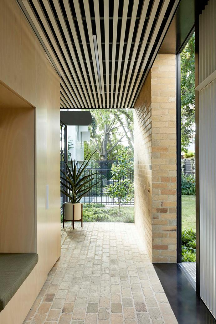 """Covered external areas and glass-clad internal hallways maximise views of the mature garden. """"Many of the contractors we spoke to weren't up to speed with the latest innovations in sustainability, and some were actively trying to steer us away from greener solutions. We had to convince them that we really wanted to do this."""""""