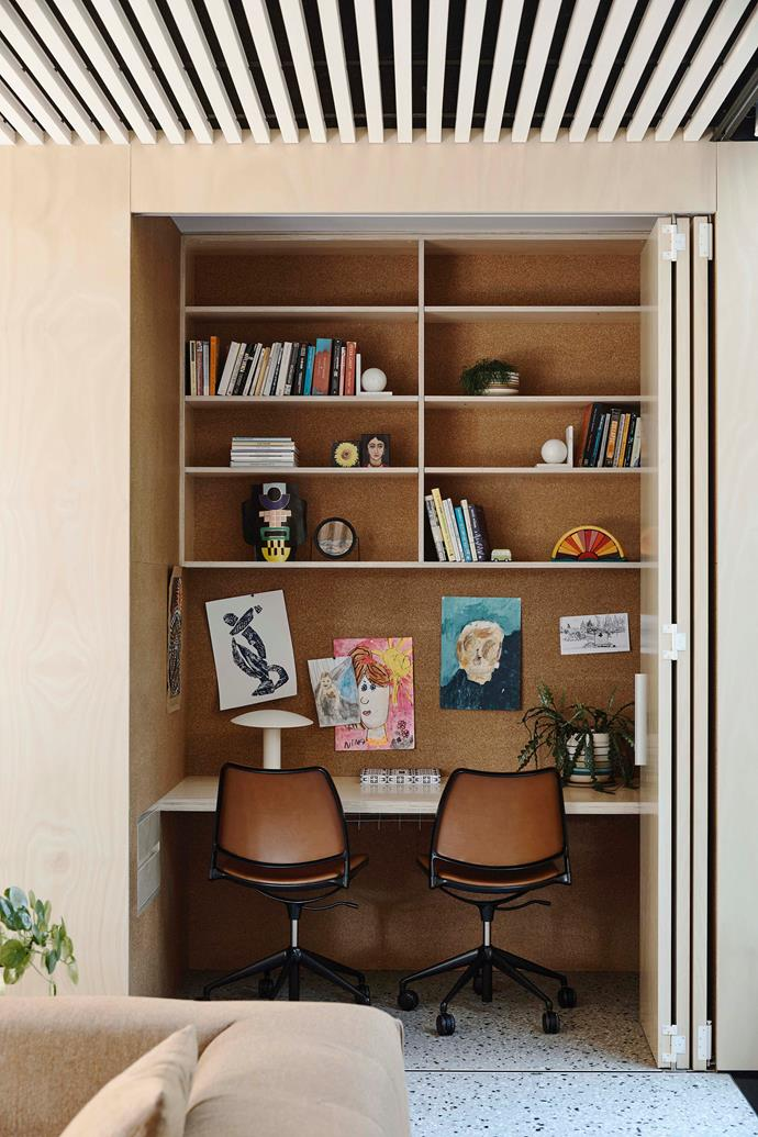 Swivel chairs by Spanish company Stua can be tucked into the desk area and concealed by a concertina door.
