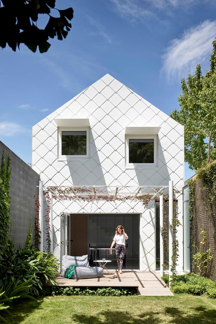 The home's rear is clad in Colorbond steel shingles in Whitehaven.