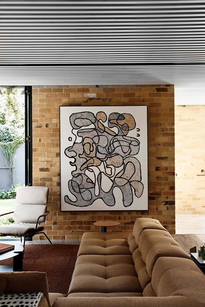 Modular Tufty Too sofa by B&B Italia. Reading chair by Moroso. Artwork by Tilau Nangala, through Papunya Tjupi Arts.