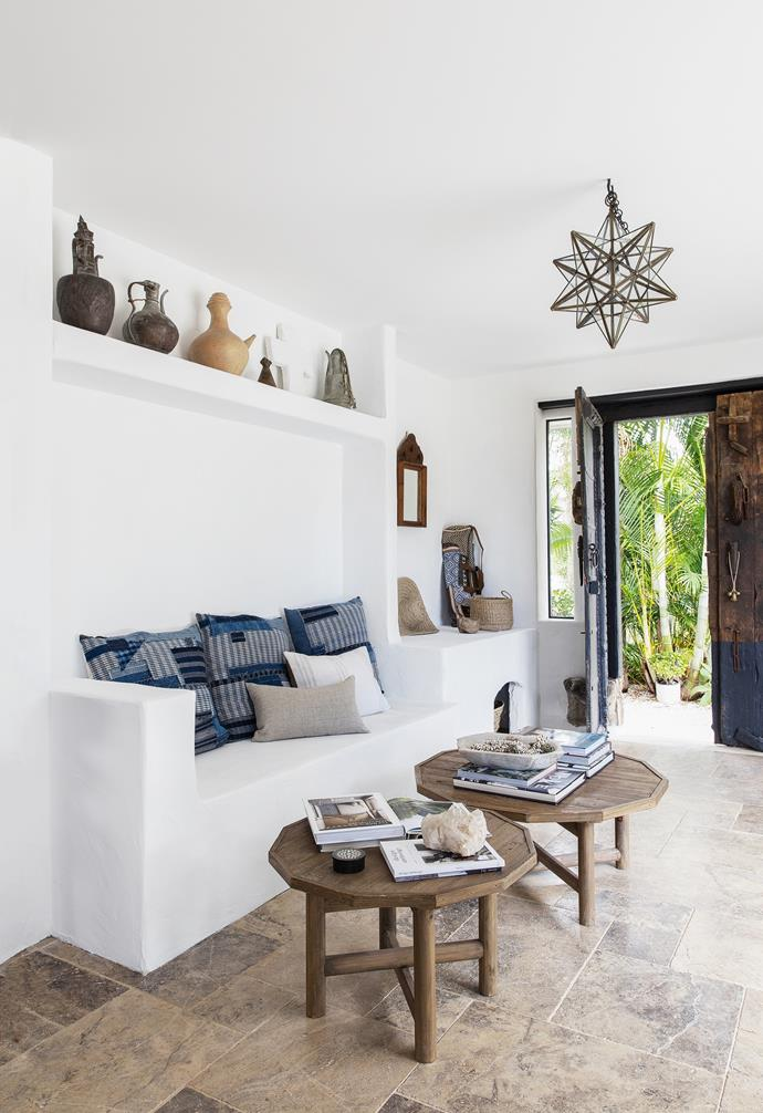 """The final piece of the layout puzzle was in relocating the entrance, then incorporating a new opening to fit a chunky vintage Indian door from Ha'veli. Underfoot, marble [travertine tiles](https://www.homestolove.com.au/travertine-tiles-ideas-22812