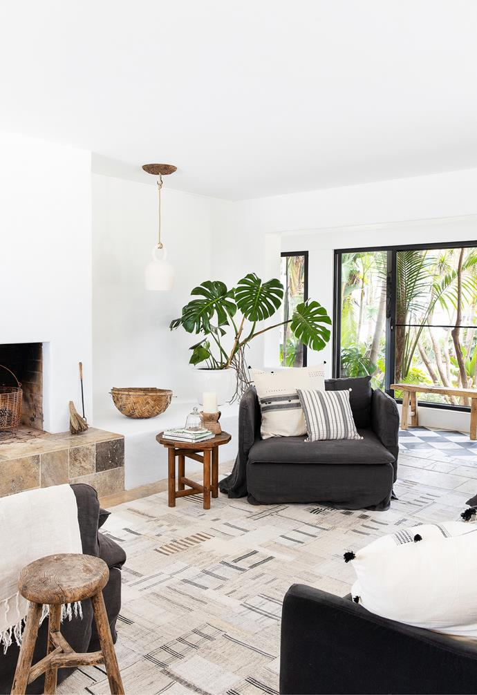 An Ikea sofa and occasional chairs, dressed in linen slip-covers from Bemz and kilim Casa Bohemia cushions, create a serene space, warmed by the fireplace built by Brad's dad, Rocket, a retired stonemason. A Klaylife pendant and Bisque Traders ceiling rose add a sculptural element.