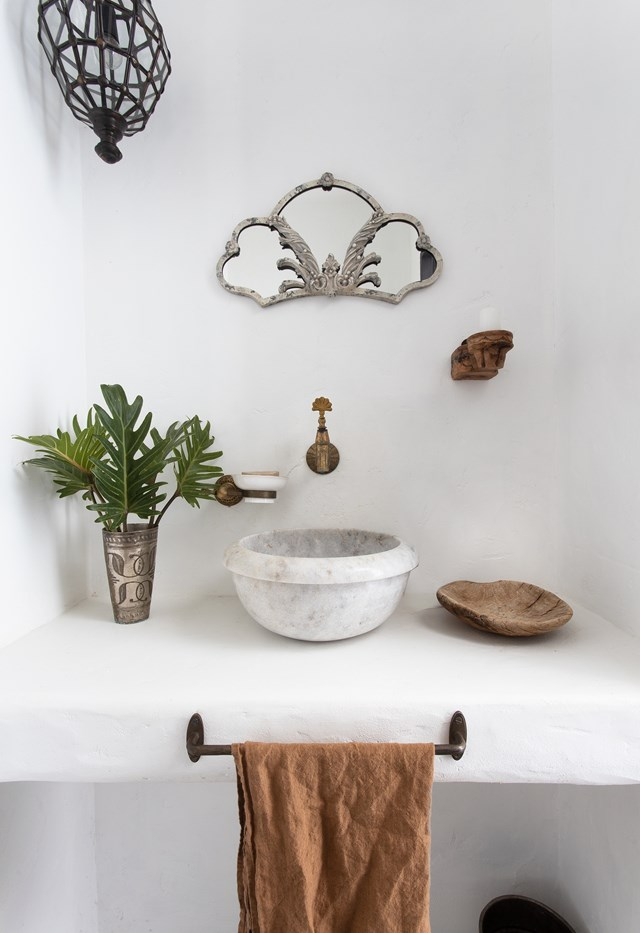 """History and heart. Collected objects surround the rendered vanity surface in the bathoom of [this Byron Bay home](https://www.homestolove.com.au/rustic-mediterranean-home-byron-bay-22833