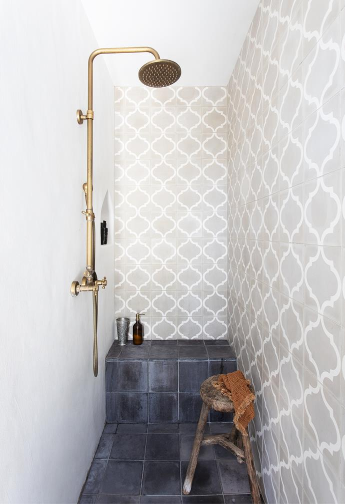 Brass fittings, including tapware from Ottoman Imports, a marble basin from Bisque Traders and a shower fixture sourced overseas contribute a warm, aged elegance (for similar try Abi Interiors).