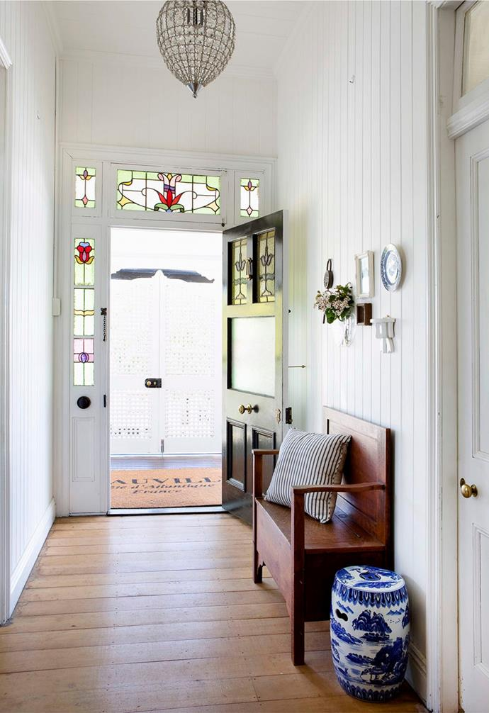 The crisp palette carries through to the interior via the pretty hallway. Both the leadlight windows and door are original.