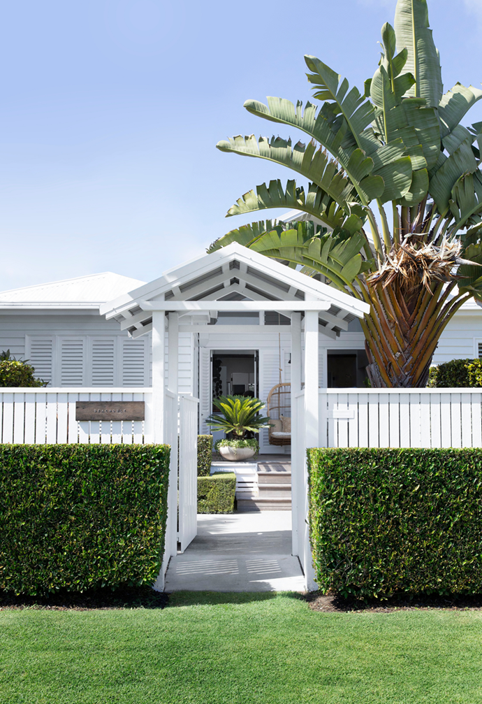 """Years of hard work paid off for a Queensland couple whose love for landscaping and flair for interiors turned their beachside abode into a holiday-at-home oasis [fit for the Hamptons](https://www.homestolove.com.au/white-coastal-home-queensland-22306