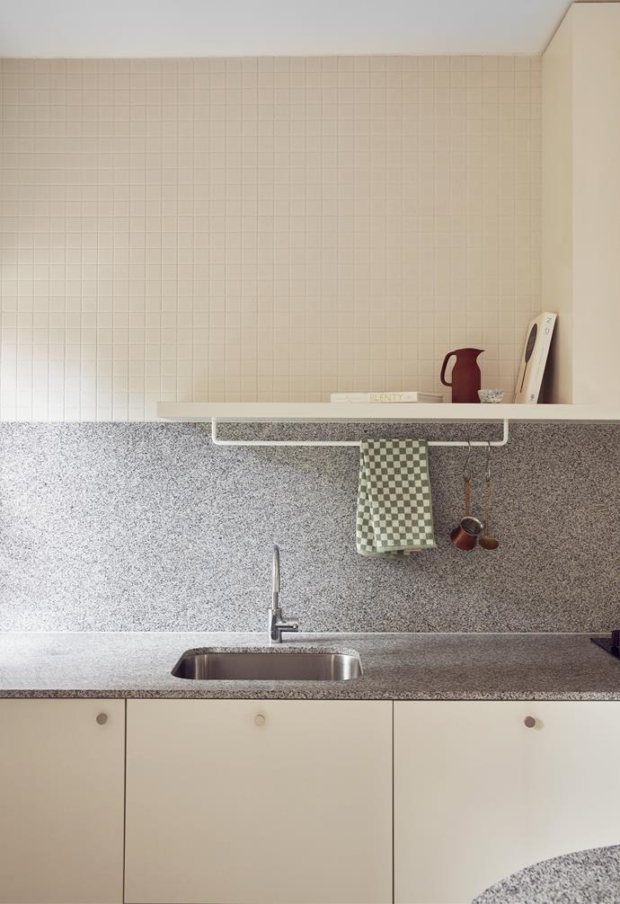 Beautiful yet durable materials were used in the renovation of this kitchen, from Polytec laminate in the cabinetry, to the mosaic tiled splashback and vast terrazzo benchtop from Signorino. A hand towel from Baina, jug by Barber Osgerby for Royal Doulton and Keepresin bowl round out the look.