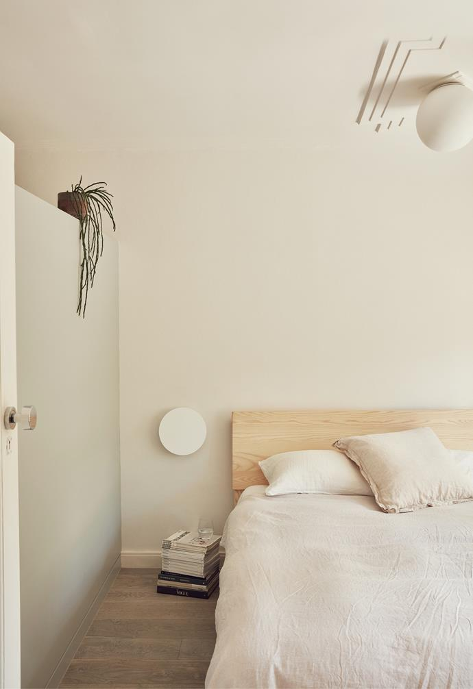 The Ross Gardam 'Polar' wall light echoes all the other round silhouettes, while existing period details have been retained and updated – for instance, a modern Artemide 'Dioscuri' light that sits within the old ceiling rose. The bedlinen is by In Bed.