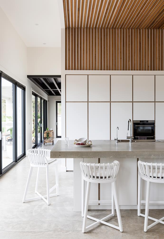 """For casual mealtimes, they gather around the [kitchen island bench](https://www.homestolove.com.au/15-game-changing-kitchen-islands-for-your-renovation-13253