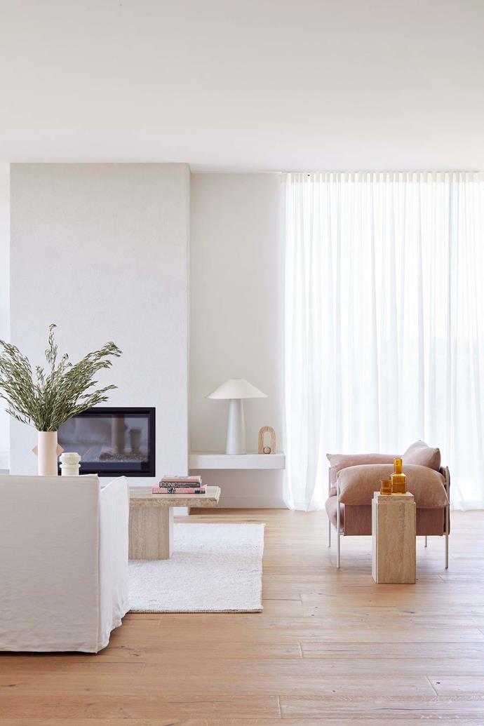 In the living room, the fireplace is rendered in a Dulux Linen White finish that looks great with the Dulux Natural White (half) walls of the home. HK Living Lamp, House of Orange.