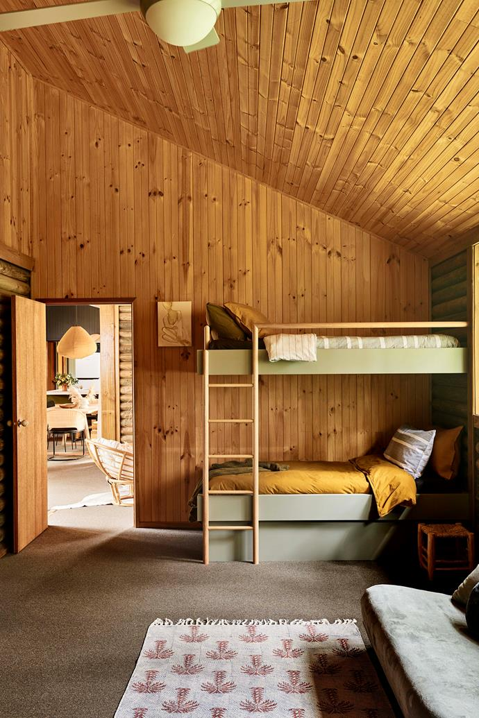 """a rug from Lumiere Art & Co enlivens the children's room, which receives abundant natural light. The bedding throughout the cabin is a mix of items from Kip&Co, Jardan and [Adairs](https://www.adairs.com.au/