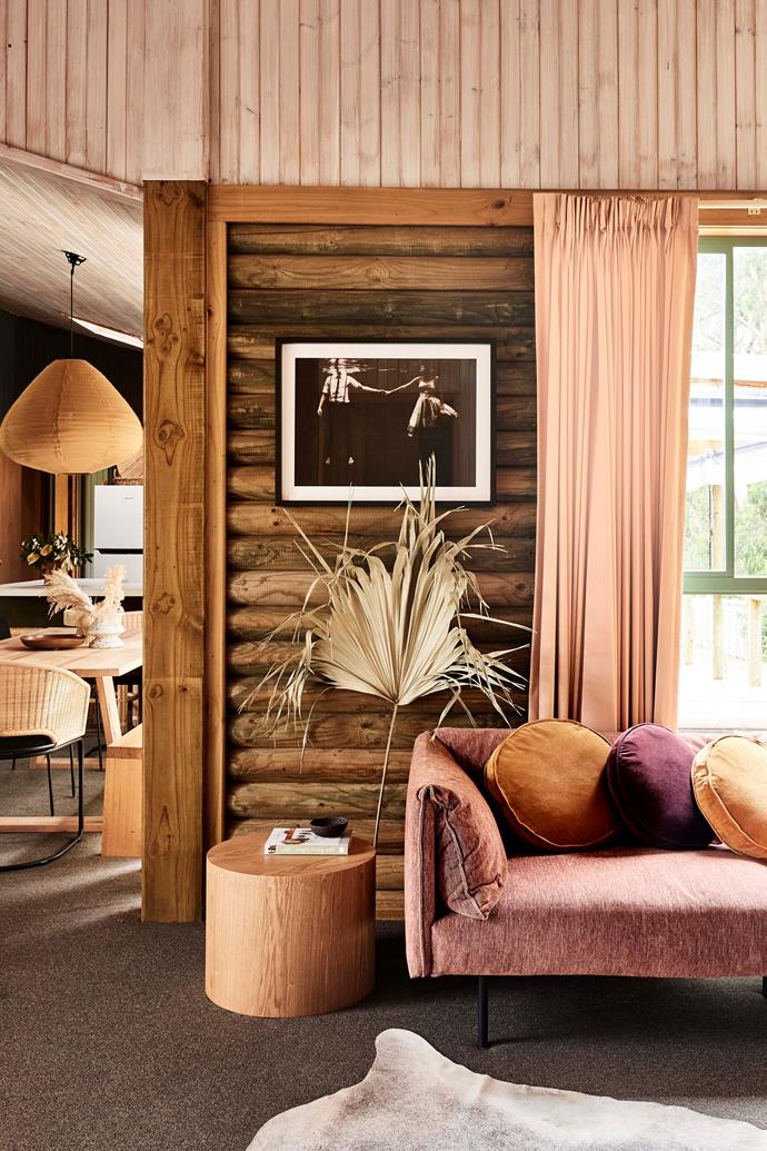 Owner Emma devised a palette of earthy tones to complement the cabin's wooden structure and harmonise with its natural surroundings.