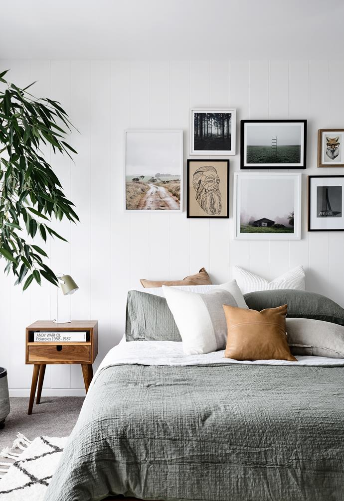 """This tranquil room promises family and friends a dreamy sleep on the 'Spindle' bed frame from Domayne, or a good read propped up by a huddle of Adairs cushions. Beacon Lighting pendants hang above [bedside tables](https://www.homestolove.com.au/best-bedside-tables-18353