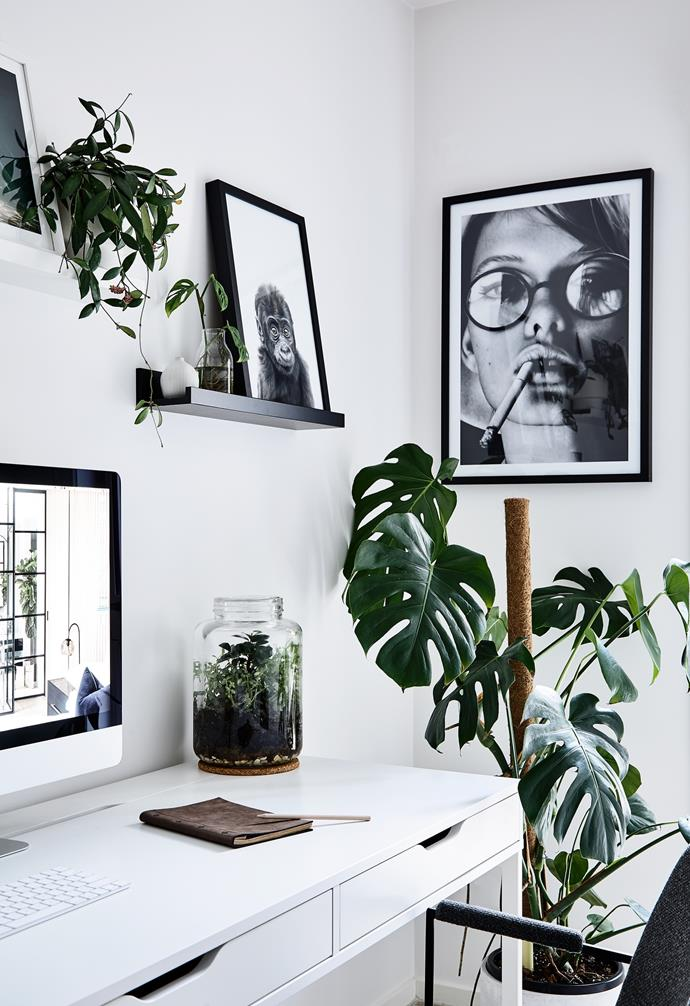 """The workspace celebrates Scandi hallmarks of simplicity, functionality and an abundance of plants. Jamie says, """"The decor is intentionally monochromatic as I find it easy to work in."""" His study features an Ikea desk, Globe West chair and Benny Planter in White from Middle Of Nowhere. """"I chose prints that were a little edgier and modern, too – we got the portrait online from The Print Emporium,"""" he says."""