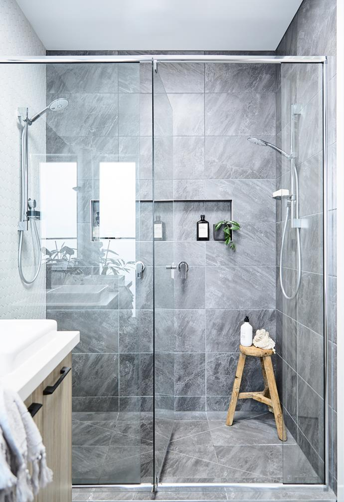 Az and Jamie splashed out on large floor-to- ceiling tiles and a hexagonal tile feature wall in their double shower. Tiles from Surfaces by Hynes, all tapware by Caroma.