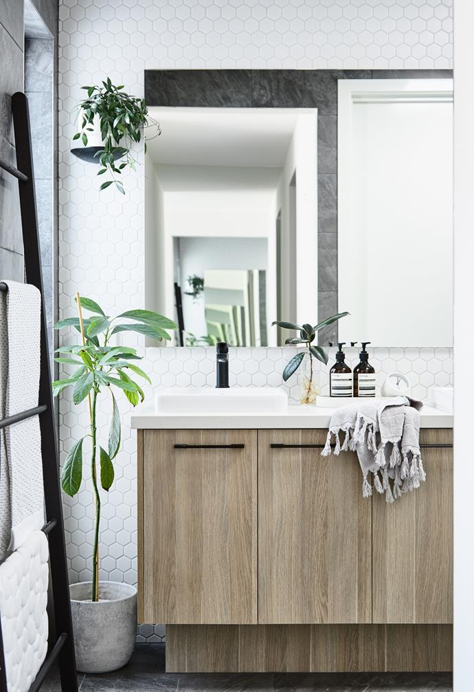 Matt black Caroma taps and the Polytec Ravine cabinetry bring luxe to the ensuite.