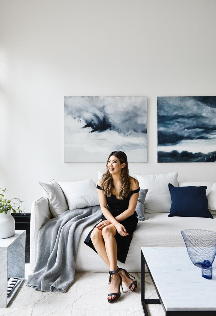 """In her Melbourne home, Lisa Teh has brought a [monochrome palette](https://www.homestolove.com.au/how-to-master-a-monochrome-decor-scheme-5867 target=""""_blank"""") to life using texture – think linens, marble, wood and woollen throws. """"We love art, especially pieces that have a story,"""" says Lisa on a Lounge Lovers sofa and framed by two Josh Fartch artworks. """"As the walls are large, we needed big scale pieces so they didn't get lost in the room."""" A takeaway: let your art inform your finishes by translating the art's subtle hues into your upholstery. The [living room](https://www.homestolove.com.au/modern-living-room-ideas-18535 target=""""_blank"""") chandelier is from Schots and the blinds are by Sky Group."""