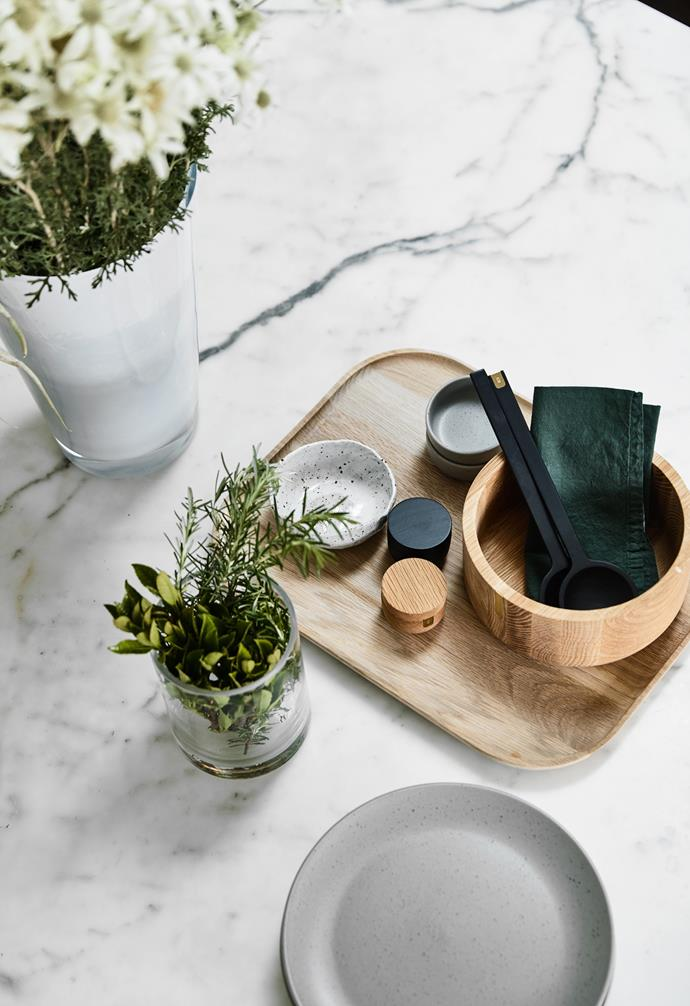 """""""We've started collecting beautiful ceramics for the kitchen as we do a lot of entertaining,"""" Lisa says. She found the assorted ceramics, timber tray and bowl at Country Road. Grouping utensils and cooking necessities in trays and textured vessels is a great way to [reduce kitchen clutter](https://www.homestolove.com.au/tricks-to-declutter-your-kitchen-13665 target=""""_blank""""). """"Our home is very clean and uncluttered, which is how we like to live our lives,"""" says Lisa. """"Whenever I first enter our home I feel a sense of calm."""""""