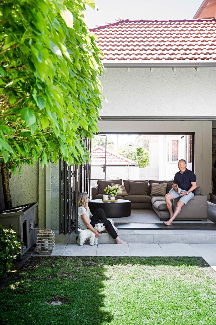 Mark and Rachel Beretta take in the sunshine in the sitting room of their northshore Sydney home.