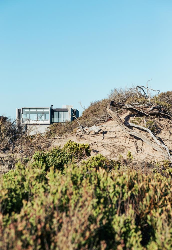 Set atop the dunes of Blairgowrie Beach on the Mornington Peninsula, this ocean-front property enjoys unrivalled views of Bass Strait and Port Phillip Bay.