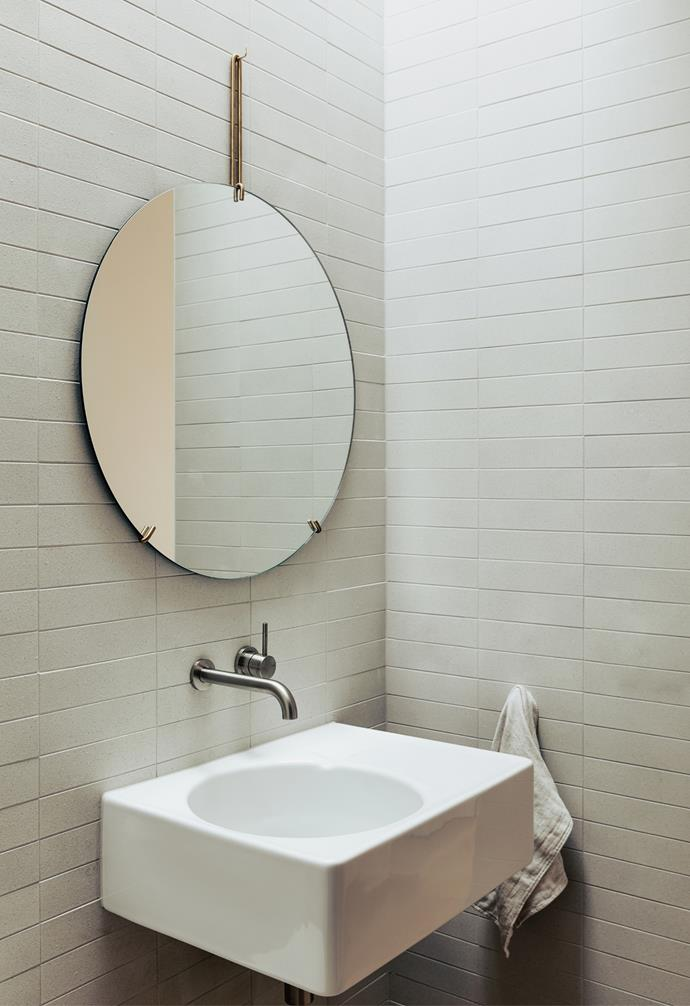 The powder room may appear to feature exposed brick but is actually fitted with a beautiful textured tile from Artedomus that changes in appearance as the sun moves across the skylight throughout the day.