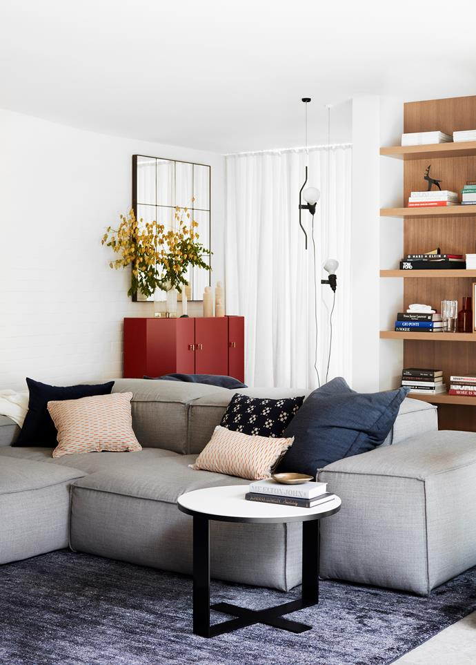 The casual sitting area has a custom sofa and B&B Italia 'Eileen' side table from Space on a cashmere abrash rug from Cadrys. Cushions from Planet and No Chintz. White throw from InBed. Bronze bowl from Pond. Shelving is in tallowwood. Parentesi suspension light from Euroluce. Tom Dixon 'Jelly' vase. Maison Balzac 'Coucou' carafe.