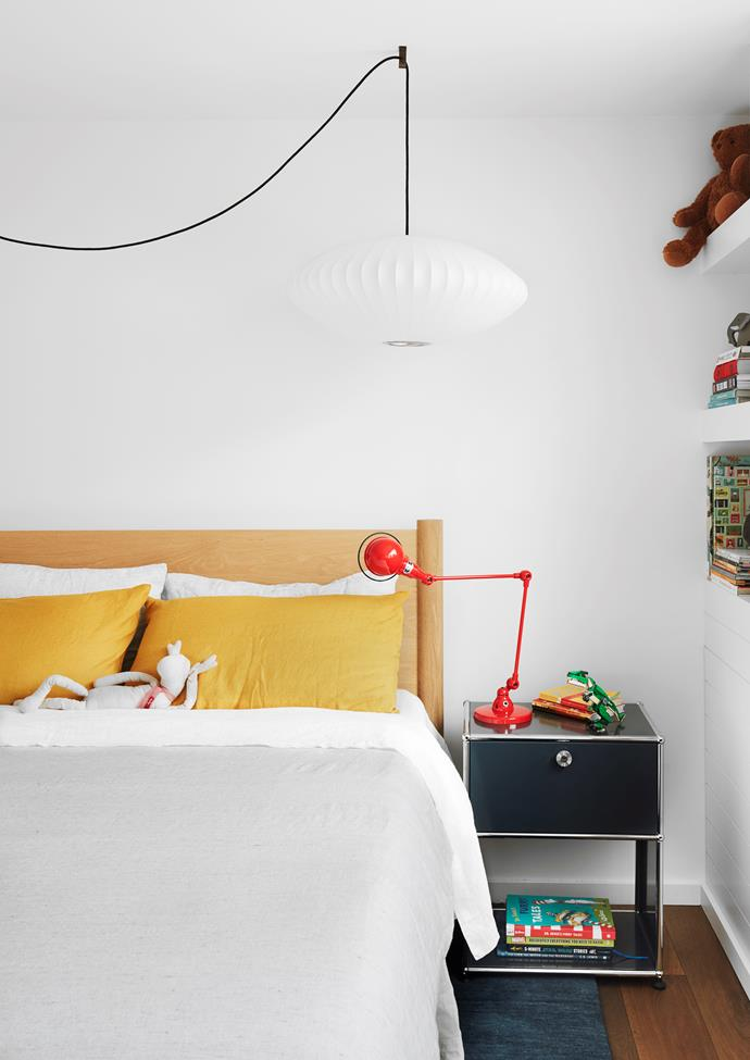 Bed from Mark Tuckey with bedlinen from Cultiver. USM bedside table and desk pedestal from Anibou. 'Nelson Saucer Bubble' pendant light from Living Edge. Charlotte Perriand wall light from Mondoluce.  Jieldé lamp from Euroluce.