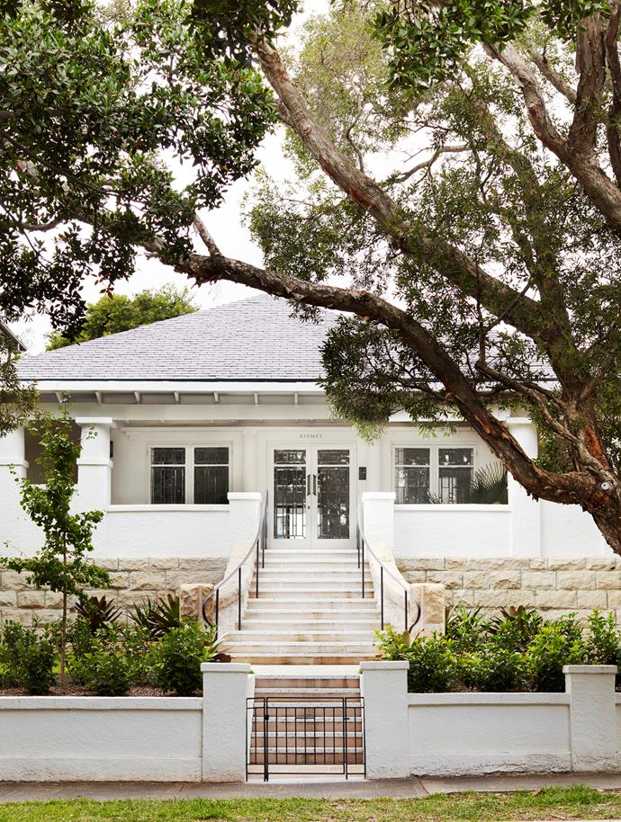 The traditional facade with central terrazzo steps and classic columns gives no hint of the sinuous timber-clad extension that lies behind.
