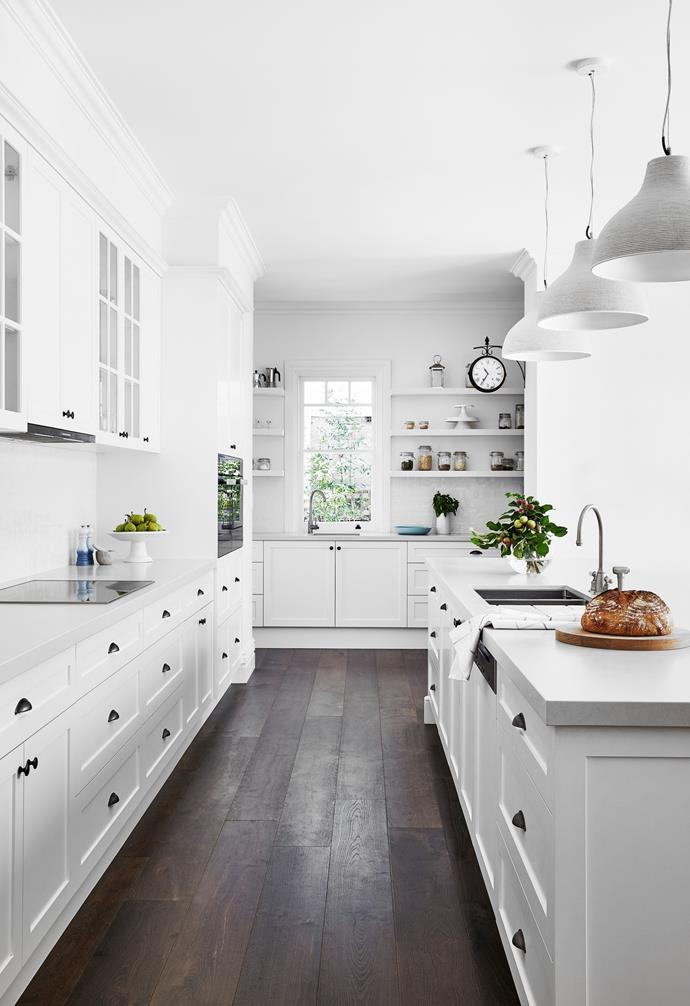 The kitchen's prep space blends past and present. Working with Shoreline Kitchens, Rachel went all out on bespoke joinery in the 'front of house' area. The pantry was then fashioned from carcasses from the old kitchen and finished with new doors. Both spaces are finished in Resene Alabaster.