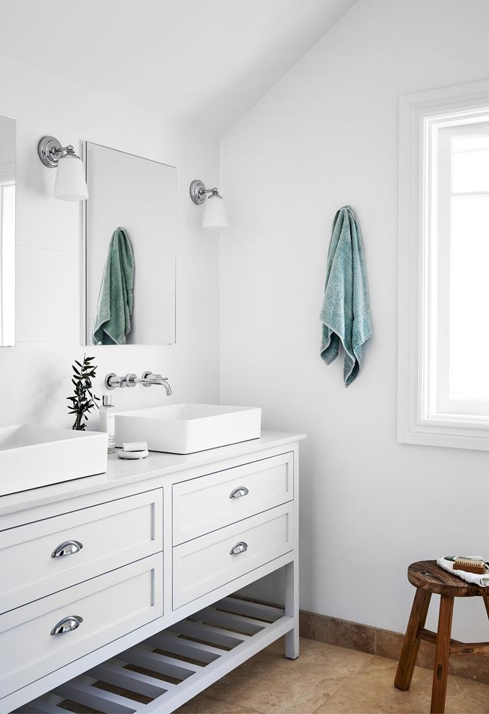 Inspired by the style of British brand Fired Earth, the custom-designed vanity (right) built by Shoreline Kitchens has a cost-saving secret; the top two drawers do not open. Rachel wanted the waste to be plumbed to the wall so there would be free space below. That meant the drawers would have needed cut-outs to fit around the pipes – a costly exercise. She made up for the lost storage by recessing the shaving cabinets into the wall, so they just look like mirrors.
