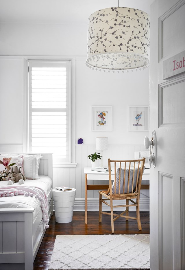 """This wainscoting uses vertical joinery, or VJ panelling, to soften the aesthetic, insulate sound and buffer the walls against the wanderings of a trundle bed in this [crisp, white children's room](https://www.homestolove.com.au/fresh-federation-home-sydney-22862