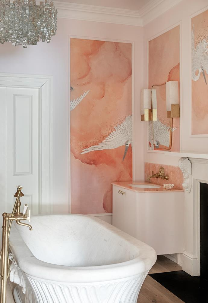 While Barry didn't agree to using pink onyx in the kitchen, Suzie got her way in the main bathroom, which is clad in marble from Miller Brothers and Phillip Jeffries 'Flight' wallpaper. The Calacatta marble bathtub from Hurlingham had been on Suzie's wishlist. The lion-shaped tapware is from Bespoke Taps, the mirrors are Gubi, the wall sconces are by Kelly Wearstler, the cabinet handles are from Anthropology and the vintage pendant is by J.T. Kalmar.