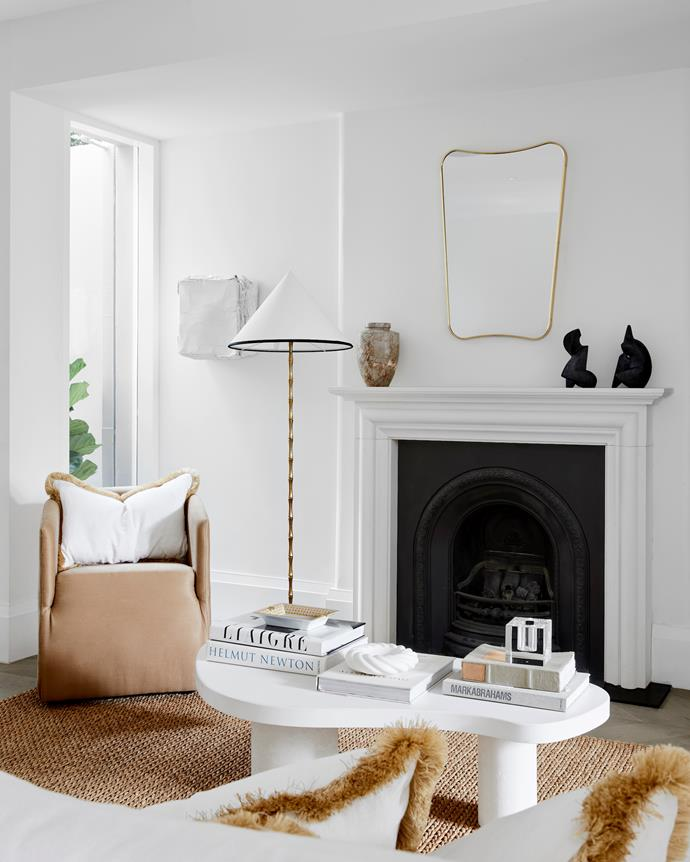 Sofa from Coco Republic with fringed Belgian linen cushions from Lucy Montgomery Collection, floor lamp from The Vault Sydney and Gubi 'F.A. 33' mirror from Cult. Sisal rug from Floorspace.
