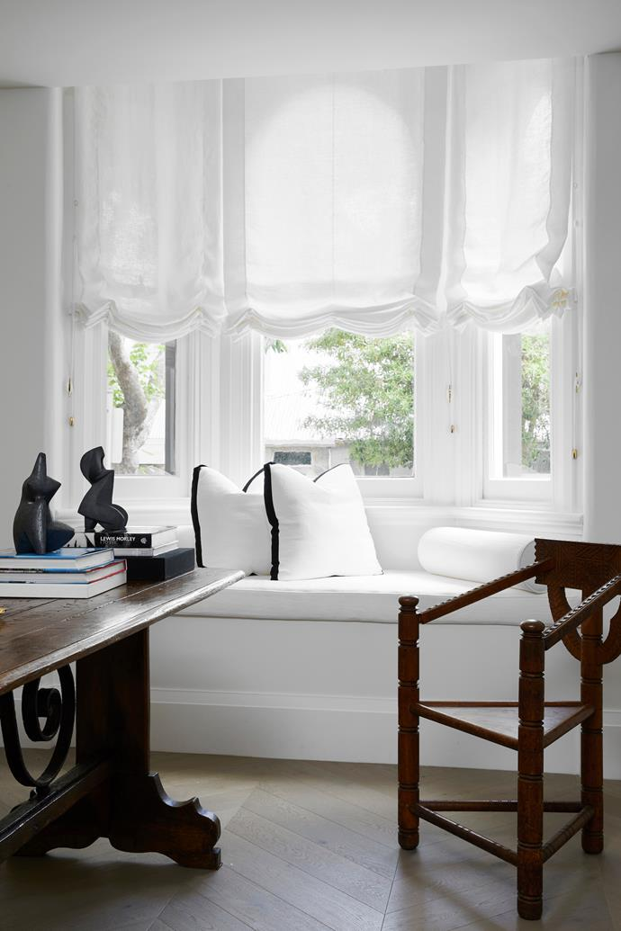 Phoebe Nicol had the window seat upholstery, Roman blinds and cushions made in linens from Westbury Textiles. Console in Viola marble, sconces and pendant light, all by Phoebe Nicol. Perspex book holder from Taschen. Wall sculpture by Dylan Farrell.