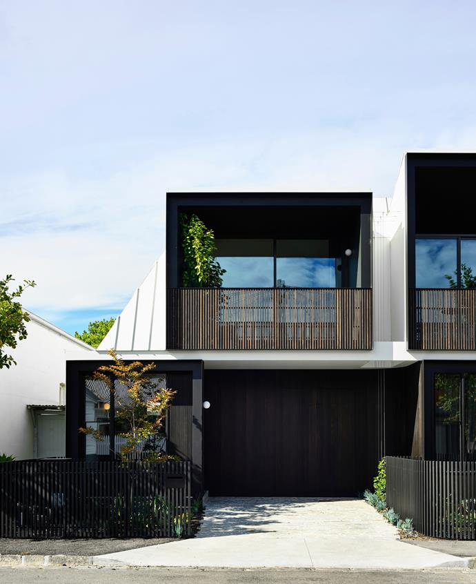 Drought-tolerant greenery specified by Mud Office can be appreciated from every window. Colorbond roof cladding in 'Surfmist'. Cedar shiplap cladding finished in Rubio Oil in Charcoal. Loden quartz pavers.