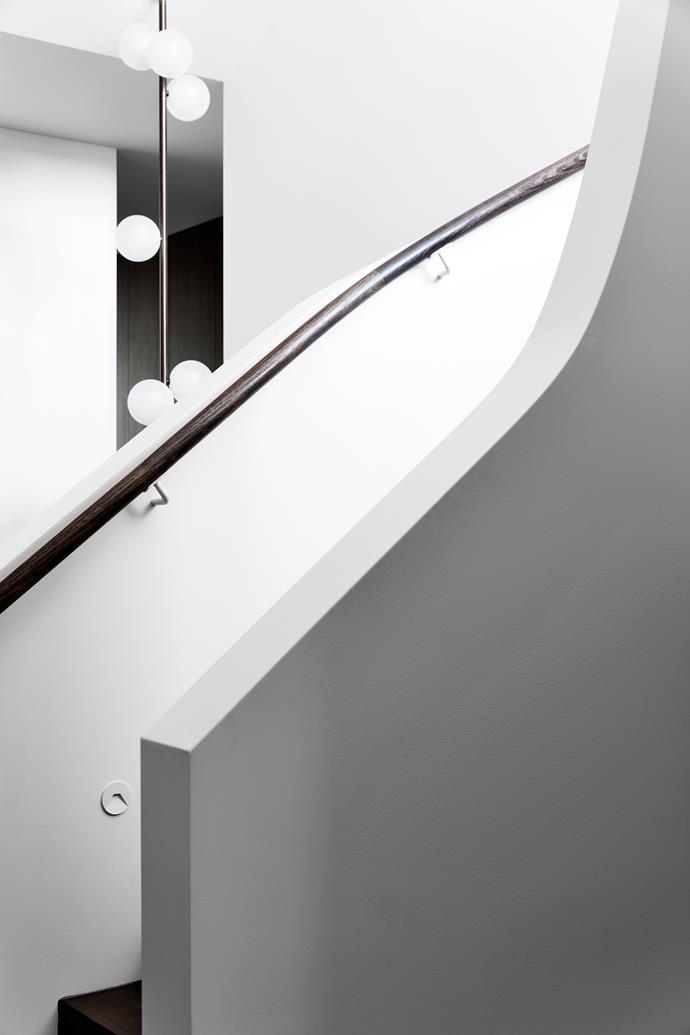 Custom chandelier in stairwell made by Giffin Design.