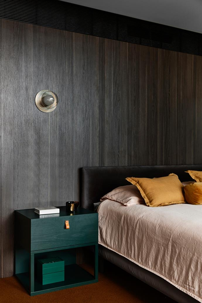 Jardan 'Nook' bed and bedding with 'Evie' linen cushions from GlobeWest. 'Leo' bedside table from Grazia&Co. Wall in Polytec 'Ravine' in Cafe Oak. Sconce by Giffin Design. SuperTuft Escape Twist carpet.