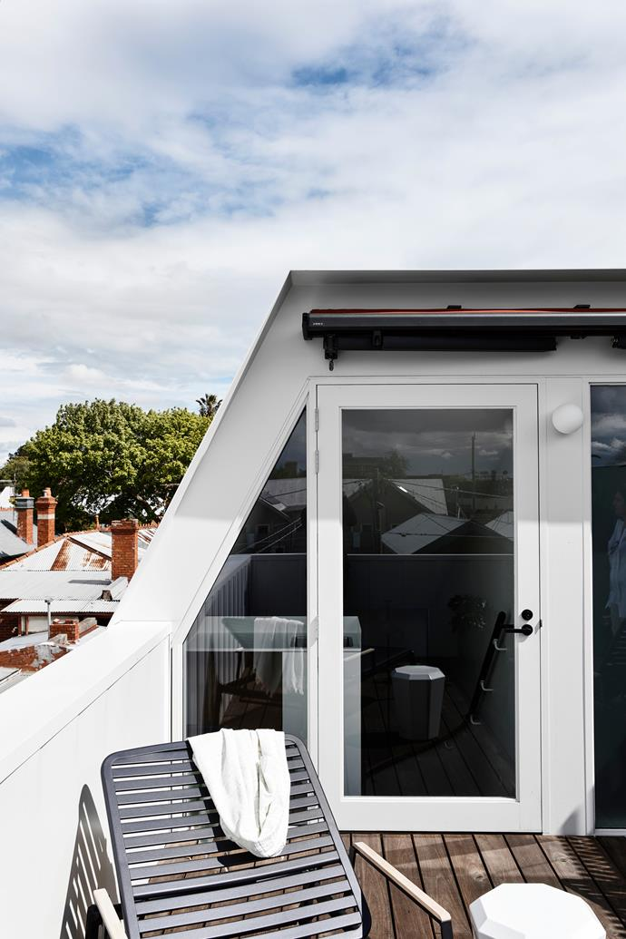 The north roof terrace on the third level is concealed behind the street front facade. From here light is drawn into the lower two floors through the stair void. 'Pier' slat sunbed from GlobeWest. 'Prisma' door handle from Designer Doorware. Artemide 'Dioscuri' outdoor wall light.