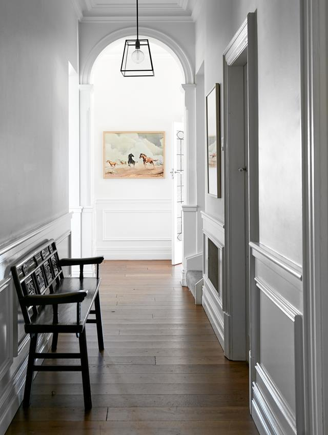"""Decorative wainscoting was added to this classic white hallway design within a [redecorated sandstone house](https://www.homestolove.com.au/redecorated-sandstone-house-mosman-22442/ target=""""_blank"""")."""