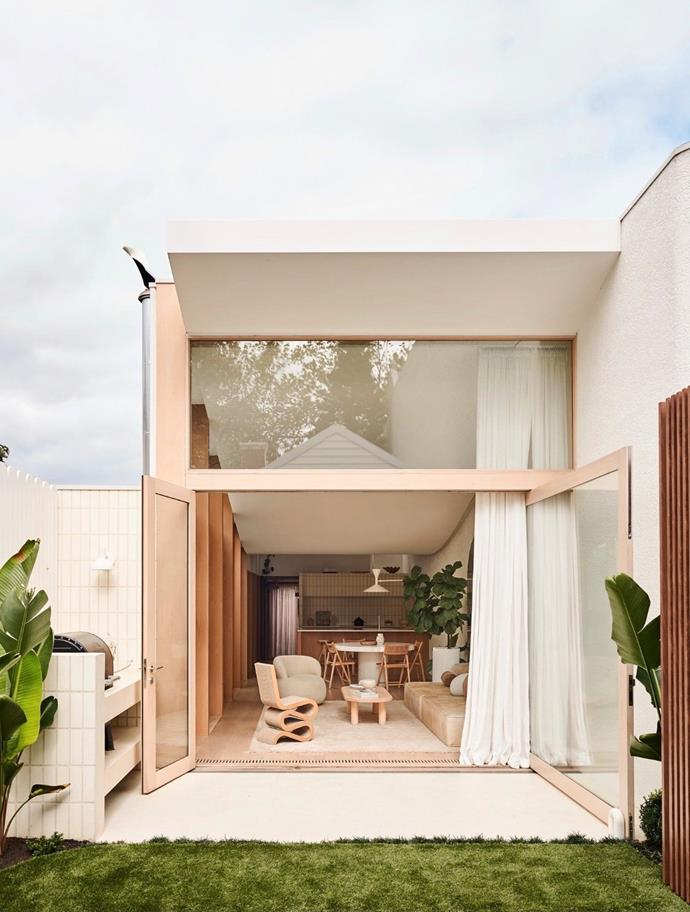 """The couple built a completely separate, three-bedroom home at the property's rear. Floor-to-ceiling windows are designed to capitalise on the home's [north-facing aspect](https://www.homestolove.com.au/the-aspect-effect-what-does-the-direction-your-property-face-mean-16229 target=""""_blank"""") and features an overized pivot door. The home was designed by [Foomann Architects](https://foomann.com.au/ target=""""_blank"""" rel=""""nofollow"""") while Jenna designed the interior herself."""