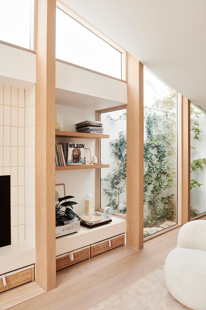 """More natural light floods in from the home's [internal courtyard](https://www.homestolove.com.au/internal-courtyards-19415 target=""""_blank"""") which frames Josh's prized record player and collection of vinyls."""