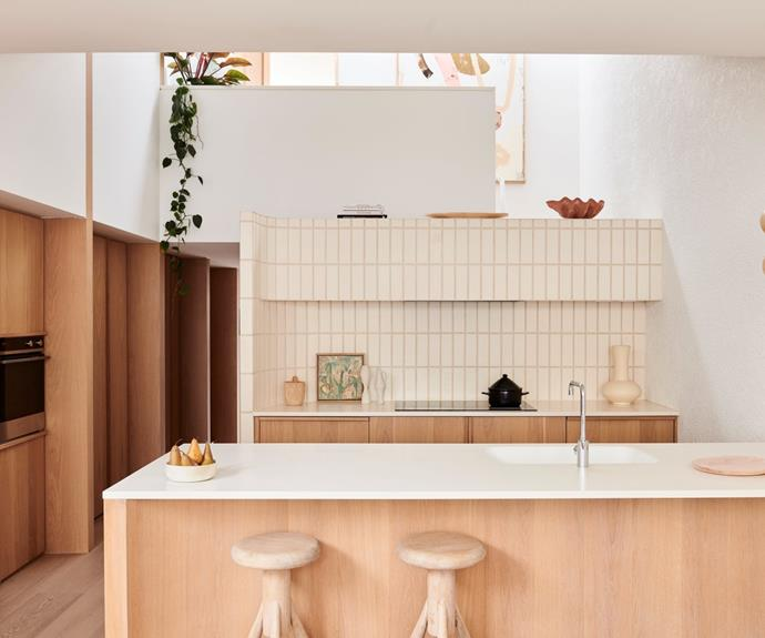 The couple maintained a consistent look throughout both dwellings. A brick splash back is the hero of the kitchen, which also features plenty of hidden storage.