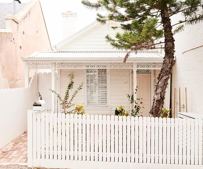 The charming facade of the original 1870s cottage. The side gate is equipped with an intercom and automatic opening mechanism that allows the family to welcome guests without having to exit the rear dwelling.
