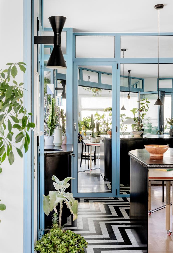 """On reflection Blue-framed doors in the [kitchen pantry](https://www.homestolove.com.au/tips-for-organising-your-pantry-3461
