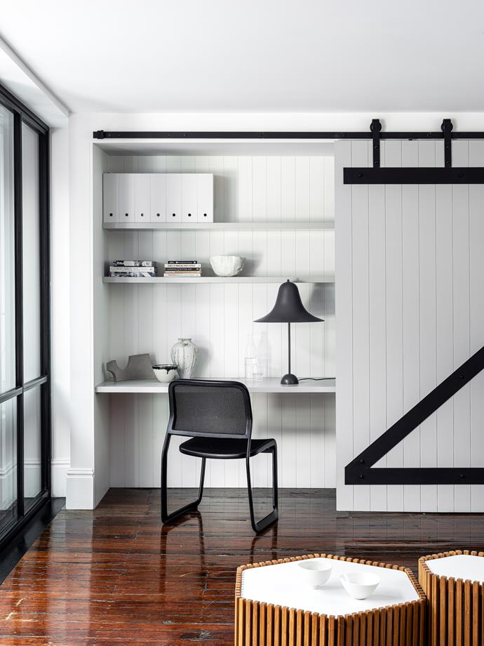 """A sliding barn door by builder Benja Build neatly conceals the study space within this [converted warehouse home](https://www.homestolove.com.au/converted-warehouse-home-21349/