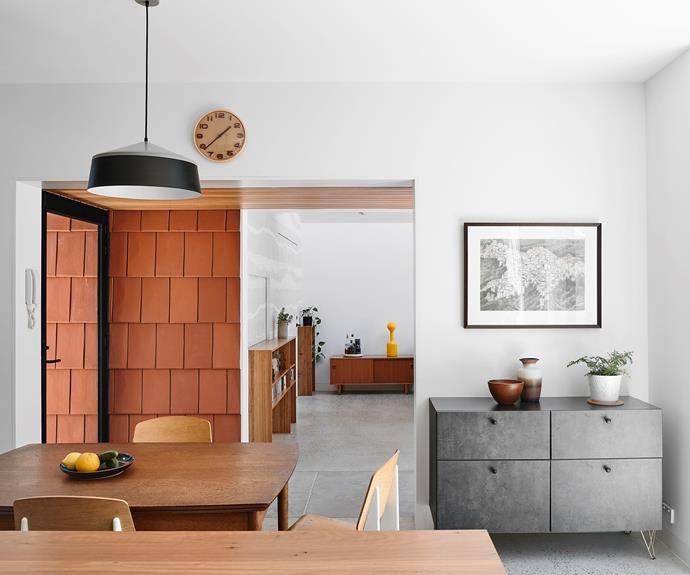 Belinda's house has all the space she needs, including a kitchen/dining room with a work area and plenty of shelves, a generous living zone and a courtyard to tend her plants.