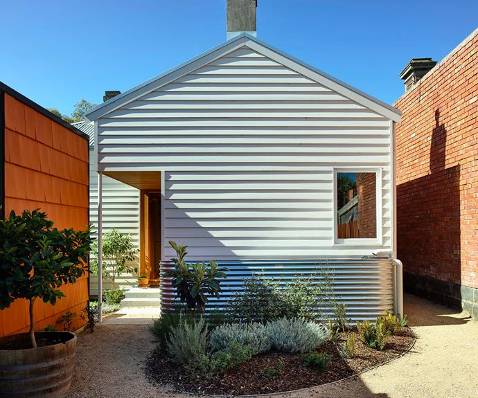 """""""This is akin to a village square, with the owner and her son's family living individually in homes on a shared block"""" Austin Maynard Architects"""